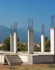 Reinforced concrete pillars on building site