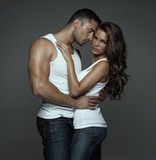 Sensual man hugging beautiful young woman