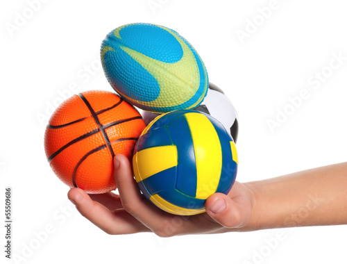Boy hand with small balls