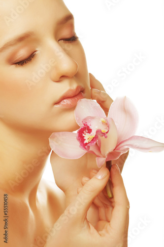 girl with pink flower on white background