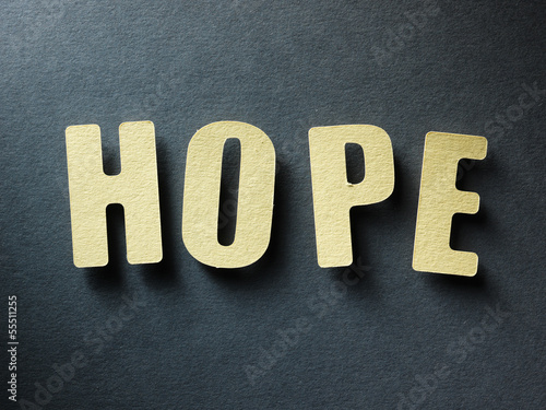 The word Hope on paper background