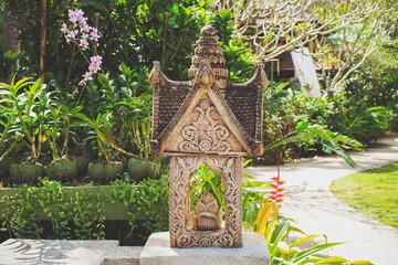 Thai statue in a garden.