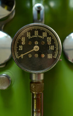 Retro Odometer On A Vintage Green Motorcycle