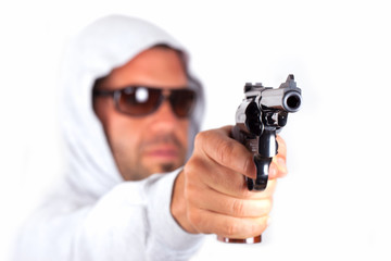 A man pointing his gun revolver.