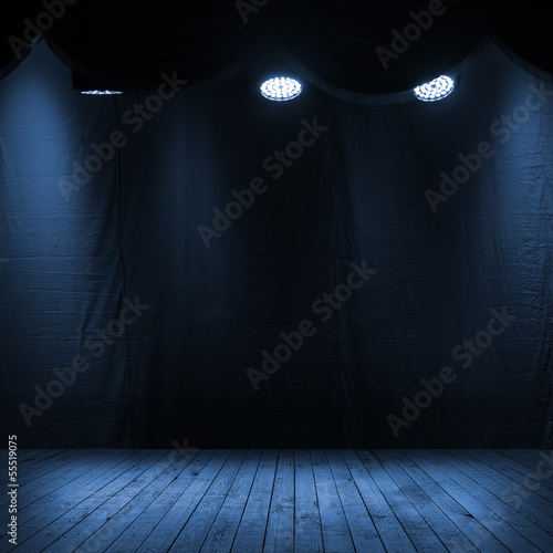 Dark blue scene interior with spotlights
