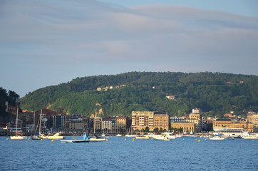 yachts on the water background of houses in San Sebastian