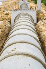 Concrete drainage duct and manhole on construction site