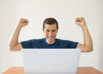 excited man with a laptop