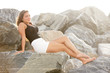 Teenager sitting on the rocks