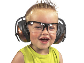toddler sitting with headphones on his head on a white backgroun