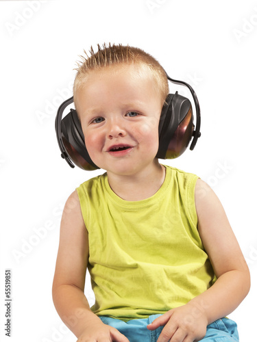 toddler sitting with headphones on his head