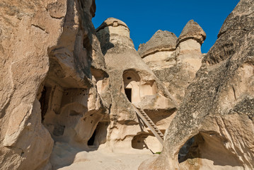 Fairy chimneys hollowed out for dwellings in Cappadocia, Turkey