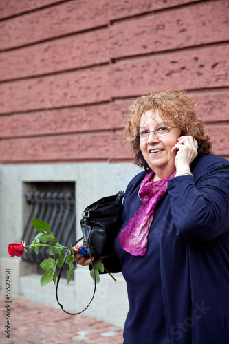 happy senior woman phone gsm