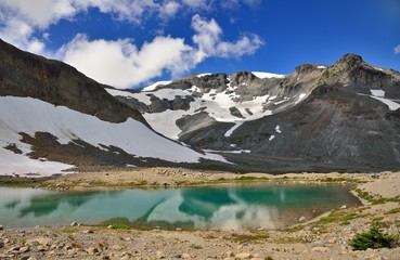Reflection of snowy mountains in a lake in Mount Rainier Nationa