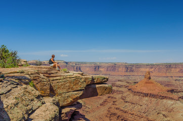 Woman Hiker Relaxing and Enjoying a Breathtaking View