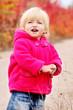 toddler girl in fall park