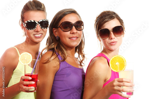 three girls fun with a drink,isolated on white background