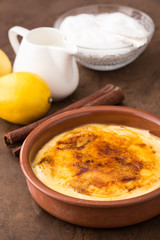 Traditional creme brulee on ceramic dish