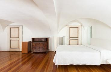 beautiful hotel room in historic building, detail of bedroom