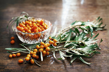 sea ​​buckthorn berries on a wooden table.