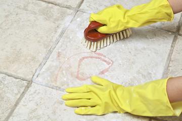 scrubbing the tiles