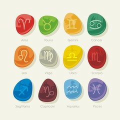 Pebbles set with zodiac signs and symbols