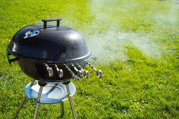 kettle barbecue grill with cover on grass