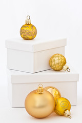 Christmas: White boxes and golden christmas ornaments