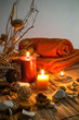 dried flowers, candles - chromoterapy - orange vertical