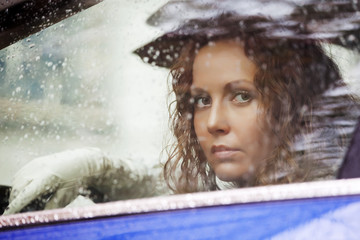 Sad woman looking out the car window