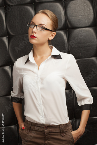 girl in a blouse on a black background