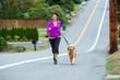 woman running with golden retriever