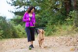 Fototapety woman walking with dog