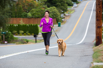 dog jogging with woman