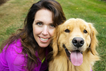 woman and her golden retriever dog