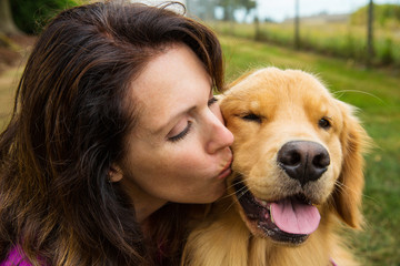 woman kissing her dog