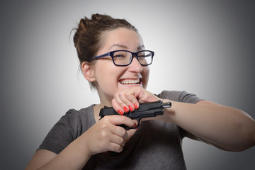 Sarcastic girl with a gun, grimace portrait
