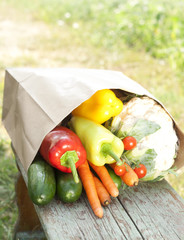 fresh vegetables on a wooden bench