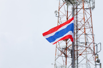 National flag of Thailand and telecommunication tower