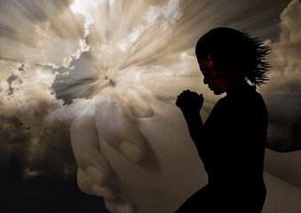 Woman praying silhouette