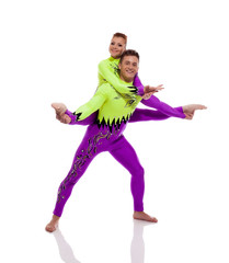 Pair of beautiful acrobats performing in studio