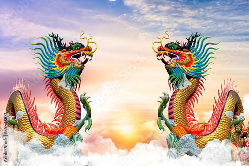 Chinese dragon at sunset in the background