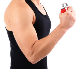 Handsome young muscular sportsman with expander, isolated