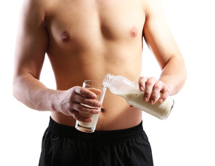 Handsome young muscular sportsman with protein drink, isolated