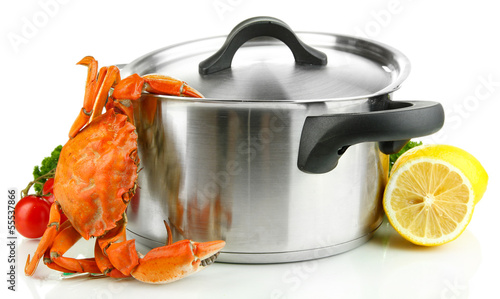 Composition with boiled crab, pan and vegetables isolated