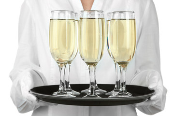Waitresses holding tray with glasses of champagne, isolated