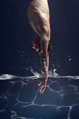 swimmer jumps into the water.