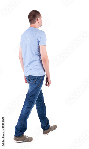 Back view of going  handsome man in jeans