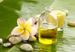 Health spa with massage oil and frangipani ,candle on leaf