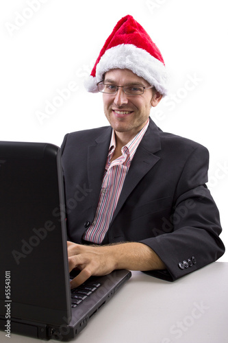 businessman celebrating Christmas by web chat on a computer